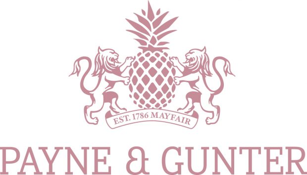 Payne & Gunter logo in pink and white with crest of pineapple and lions
