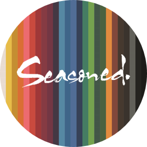 Seasoned logo on rainbow striped circular background